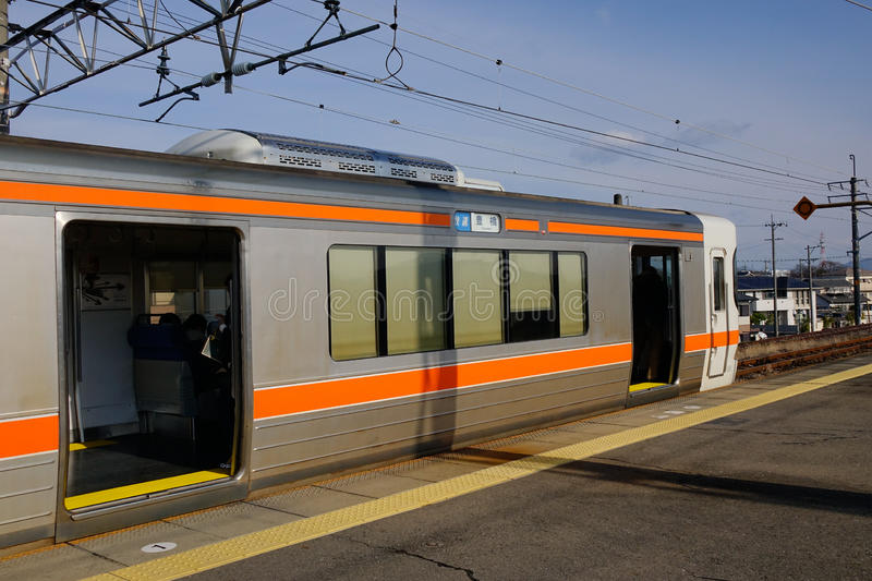 The train at station in Nagoya, Japan. The train stopping at station in Nagoya, Japan. Nagoya, capital of Japan's Aichi Prefecture, is a modern royalty free stock photos
