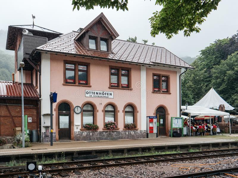 Train station railroad platform in central part of the city. Ottenhofen Im Schwarzwald, Germany - Jul 28, 2019: Train station railroad platform in central part stock photo