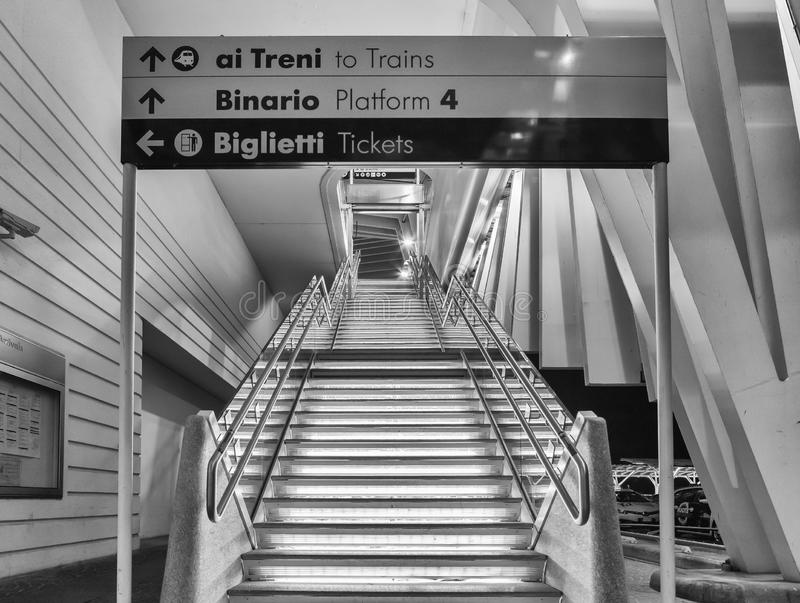 High speed train station Reggio Emilia. Reggio Emilia, Italia, May 16, 2019: high speed train station Reggio Emilia,nstairs to get to the platforms, front, black stock photos