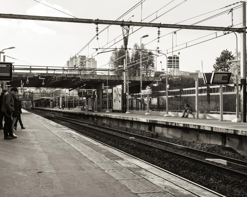 Download Train Station With Some People Waiting Editorial Stock Image - Image: 83710244