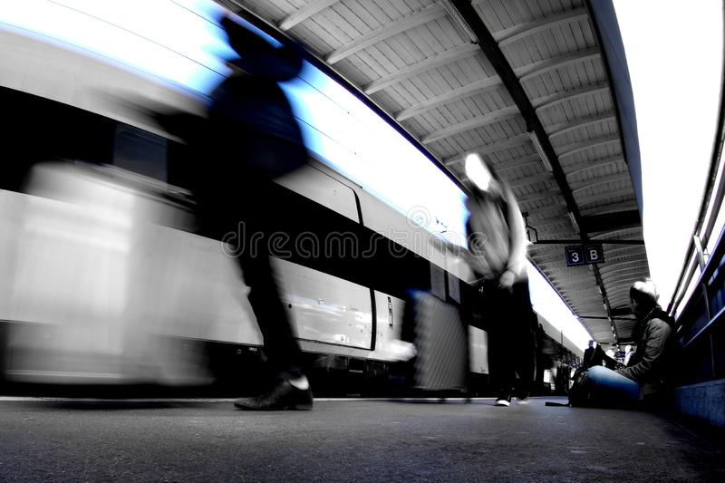The train station with three people stock photo