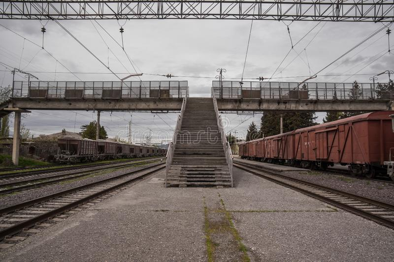 Train station with wagons and railroad tracks royalty free stock photography