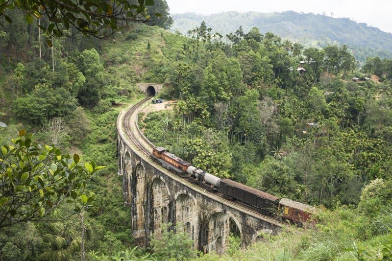 Train on a stone brigde in the mountains, Ella, Sri Lanka. Sri Lankan train in the jungle of Ella royalty free stock photography