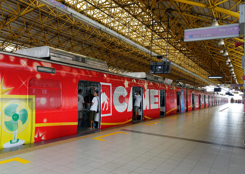 Train stopping at station in Manila, Philippines. A colorful train stopping at station in Manila, Philippines royalty free stock photography