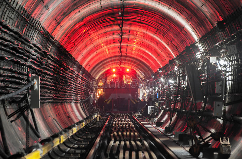 Train in subway tunnel. Focus on the train royalty free stock photo