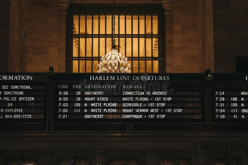 Train times and Harlem trains departure board inside Grand Central Terminal, New York, USA. stock photography