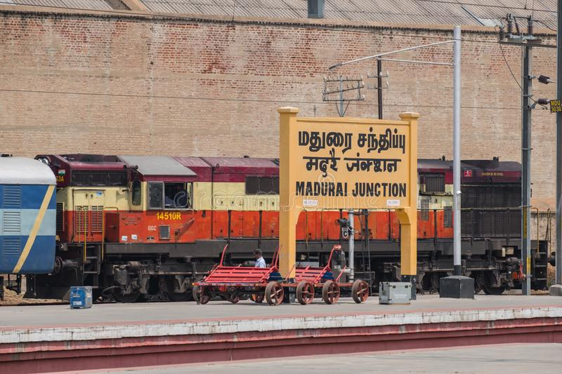 Train about to depart Madurai station, India. Madurai, India - March 10, 2018: Railway engine about to depart Madurai Junction station, the headquarters of the royalty free stock photo