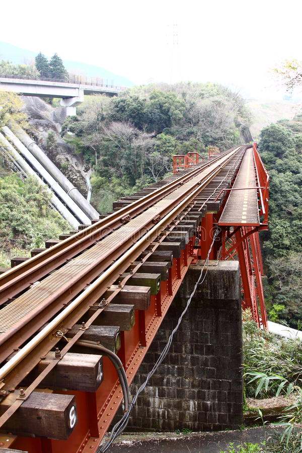 The train track bridge. The red train track bridge in Japan royalty free stock photos