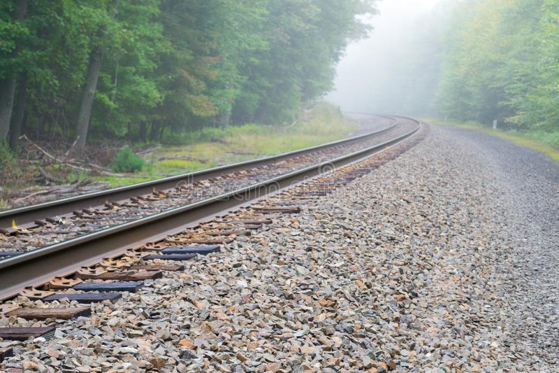 Train track into the fog royalty free stock image