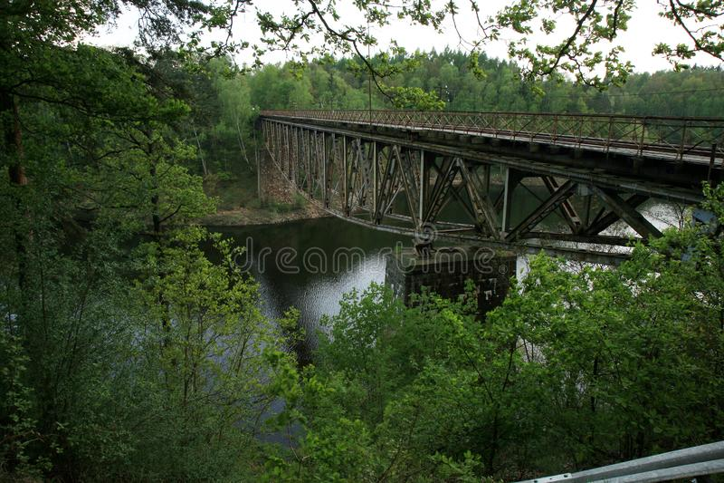 Train track on the historic iron railway bridge - Pilchowice Lake - Lower Silesia, Poland. stock photography