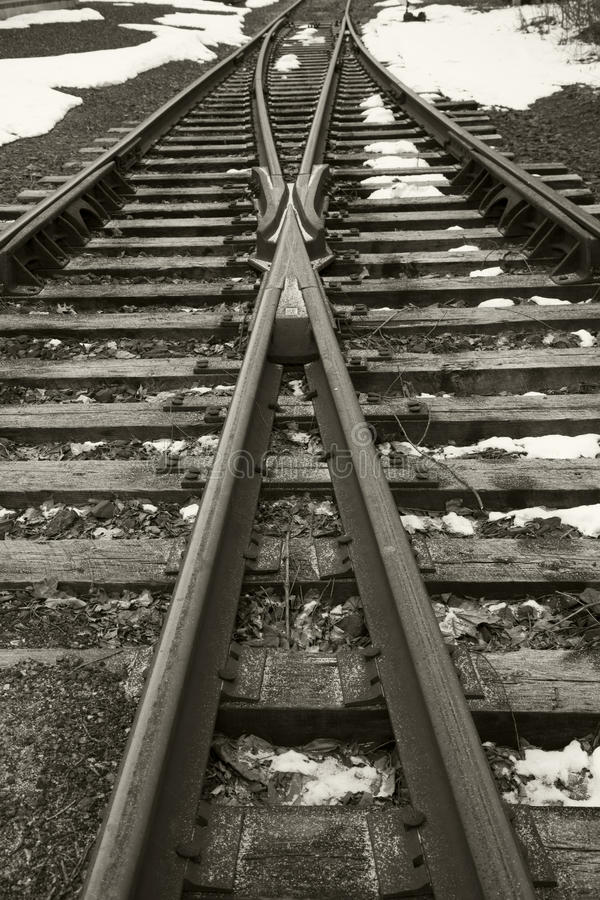 Train track in the snow. Vintage train tracks with snow in black and white stock image