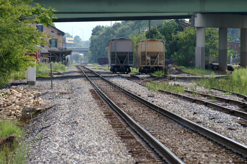 Train Track and station with cars royalty free stock photography