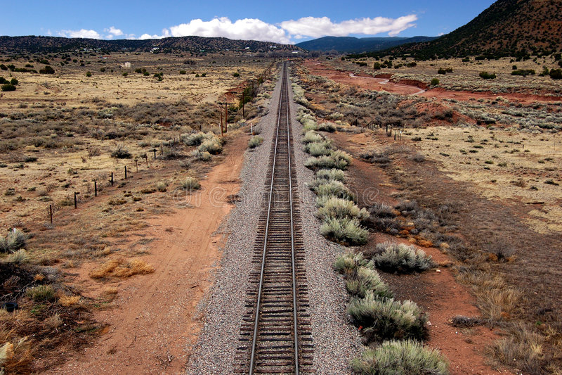 Train Tracks. Leading into the distance of a southwest landscape stock photo