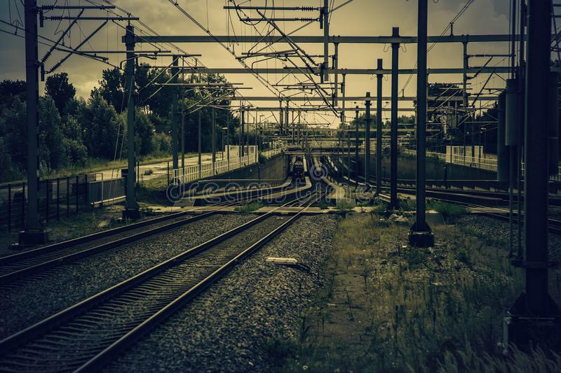 Train tracks in Amsterdam. Detail of public transport, tourism in Europe, netherlands, industry, engine, business, motion, high, speed, technology, commuter royalty free stock image