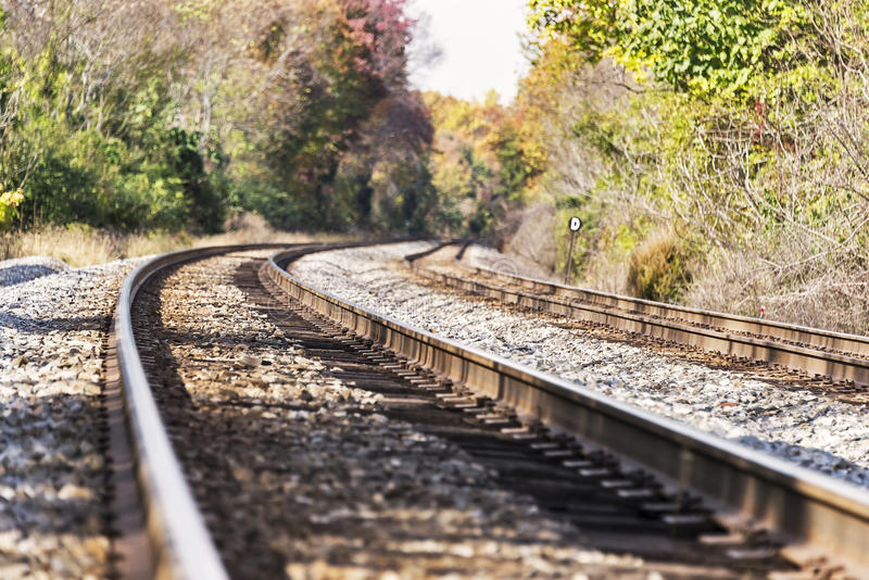 Train tracks in an autumn landscape royalty free stock image