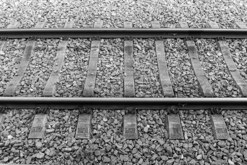 Train tracks black and white. Horizontal setting of rails with ballast, black and white scene stock images