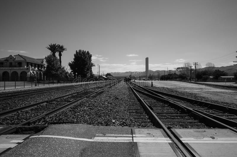 Train Tracks Black and White. Railroad train tracks, Black and White royalty free stock photo