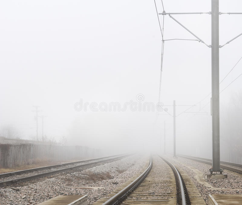 Train Tracks Disappear Into Fog 2. Some train tracks disappear into thick fog royalty free stock photos
