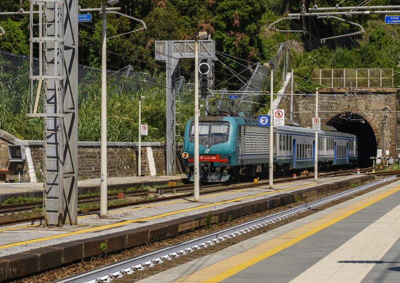 Train on tracks of the Genova Brignole railway station, Genoa, northern Italy. Pictured is a train on tracks of the Genova Brignole railway station of Genoa royalty free stock photo