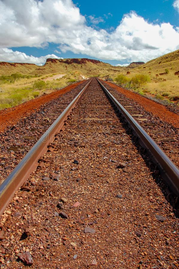 Train tracks from low angle disappear into the distance in the Pilbra, Western Australia. Train tracks from low angle disappear into the distance in the Pilbra royalty free stock images