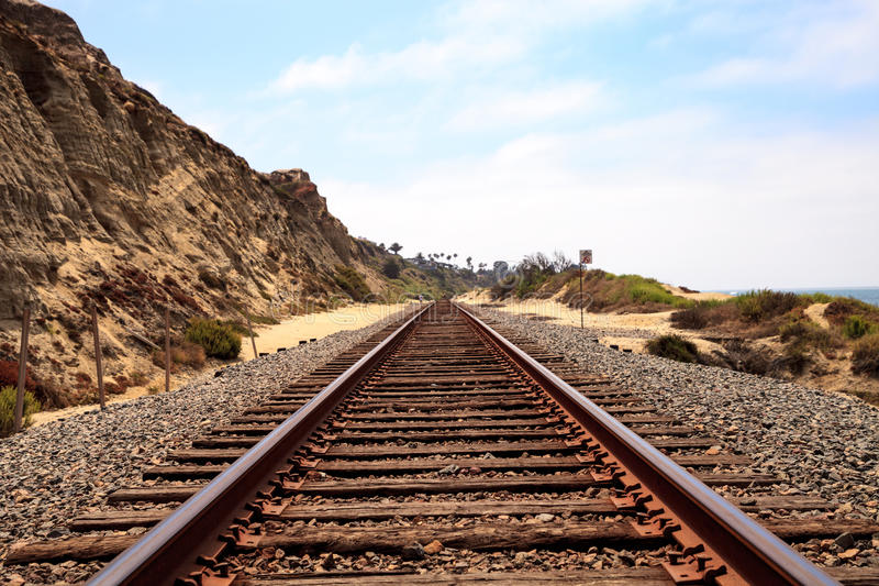 Train tracks run through San Clemente State Beach. In Southern California in summer royalty free stock image