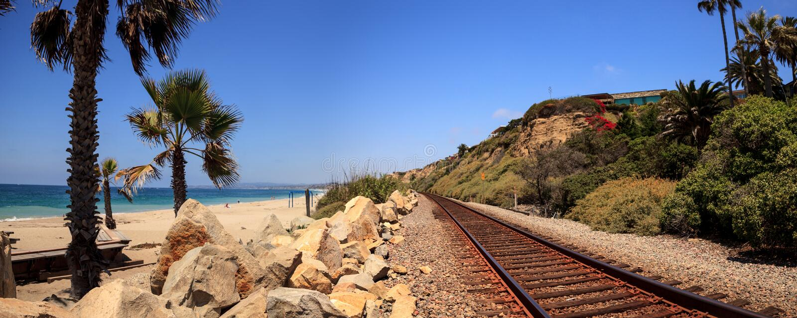 Train tracks run through San Clemente State Beach. In Southern California in summer royalty free stock images