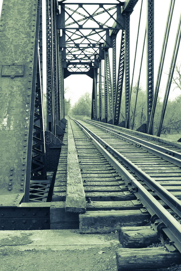 Train tracks and steel bridge royalty free stock image