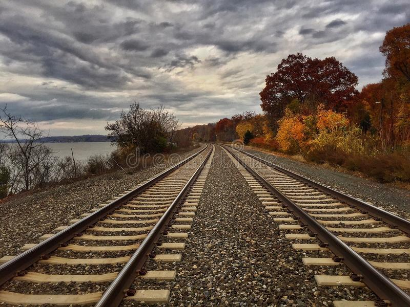 The train tracks stretch onward. Train tracks stretching into the distance royalty free stock photography