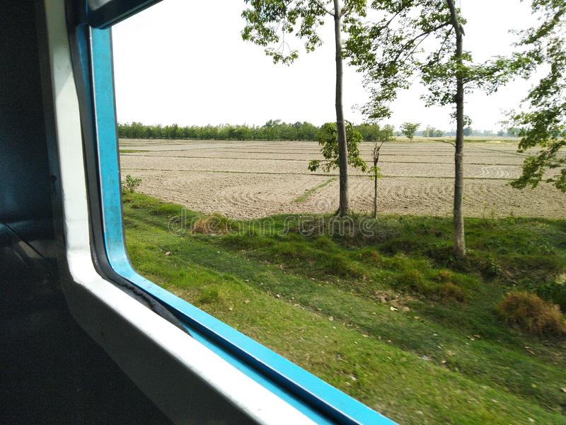 Train travel through agriculture field journey passenger window seat. Train travel through agriculture field journey passenger window stock image