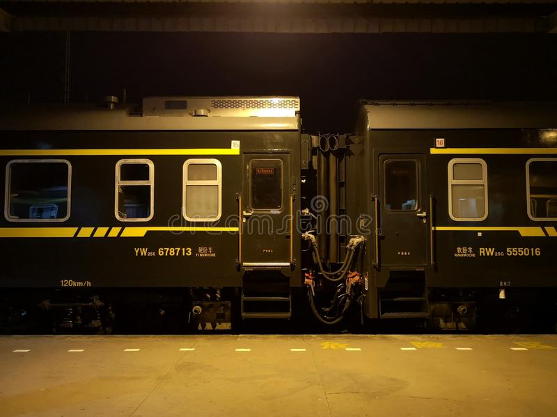 Train travel in China, green train.sleeper train stock photo