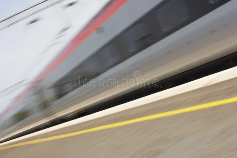Download Train Travelling Past Platform Stock Photo - Image: 8757000