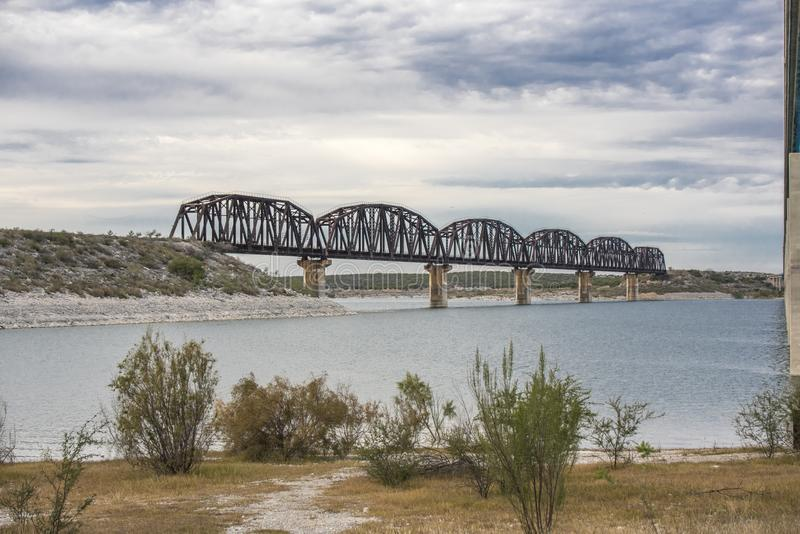 Train trestle over Lake Amistad in Val Verde county Texas royalty free stock images