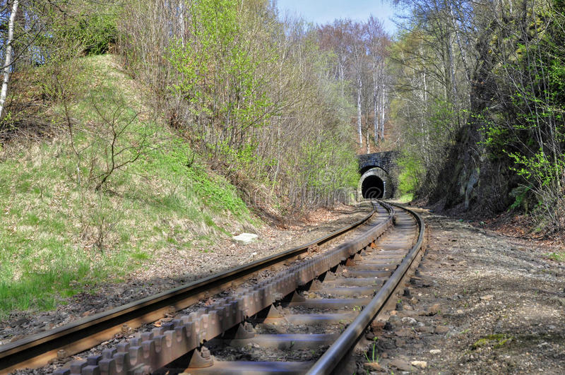 Train tunnel. And cogwheel train tracks in the Desna - Czech Republic royalty free stock photography