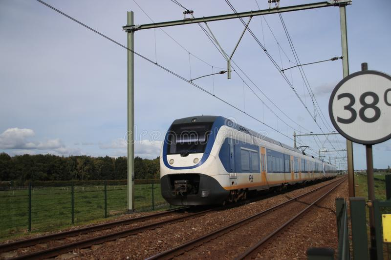 Train type SLT of the NS running at the railroad track in Nieuwerkerk aan den IJssel in the Netherlands royalty free stock photos