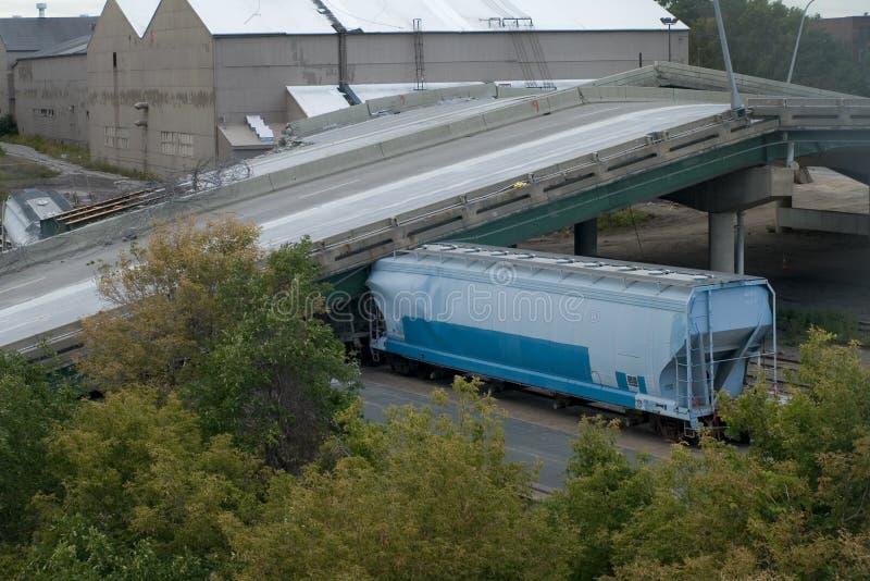 Train Under Collapsed 35W Bridge. Photo of railcar trapped under the collapsed bridge deck of 35W Interstate in Minneapolis, Minnesota royalty free stock image
