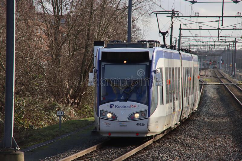 Train vehicle of Randstadrail along platform at station Forepark with tram type RegioCitadis between The Hague and Zoetermeer royalty free stock photography