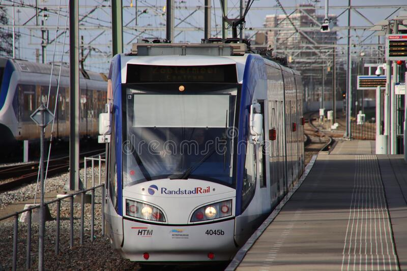 Train vehicle of Randstadrail along platform at station Forepark with tram type RegioCitadis between The Hague and Zoetermeer royalty free stock photos