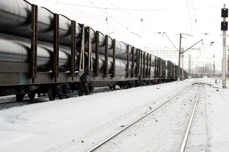 Train wagons on rails. Wagons of freight train on rails. Long train with wagons stock photo