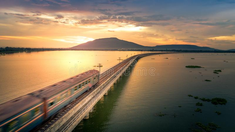 The train was running at high speed through a railway bridge Over Lake Pa Sak Dam Lopburi Thailand Beautiful Sunset stock images