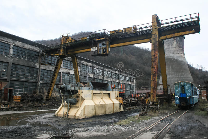 Train workshops with running bridge. Criscior, Brad, Romania, December 12, 2009: The Criscior Central Train Workshops with a gantry and metallic parts of wagons stock photos