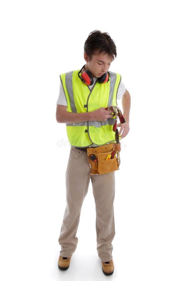 Trainee apprentice builder handyman. Trainee apprentice builder carpenter handyman construction worker or similar profession stock image