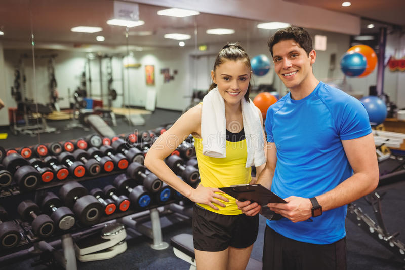 Trainer and client discussing her progress. At the gym royalty free stock images