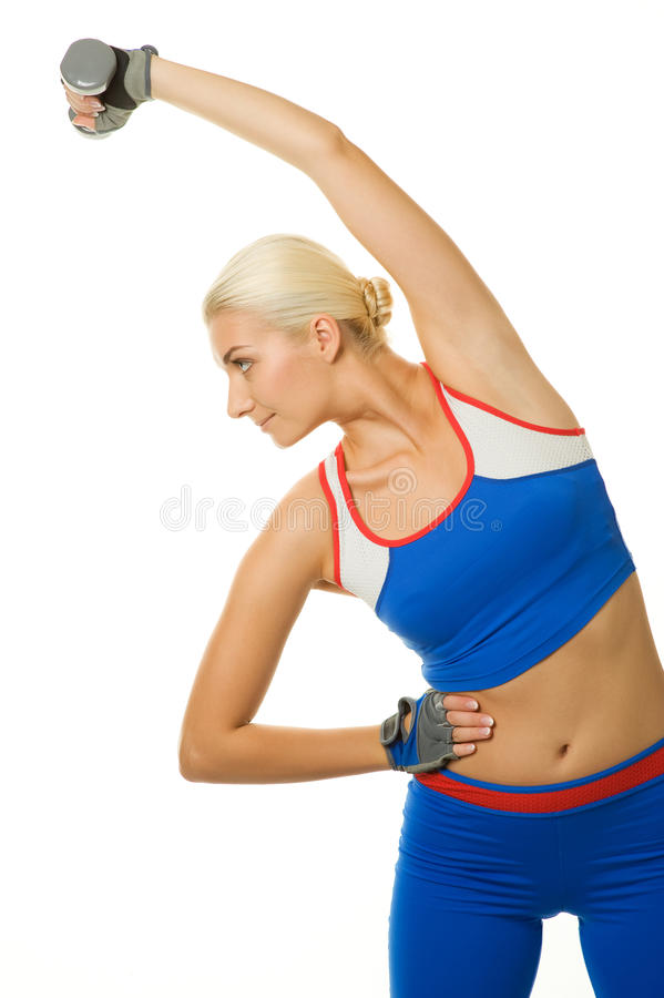 Trainer doing exercise with a dumbbel royalty free stock photo