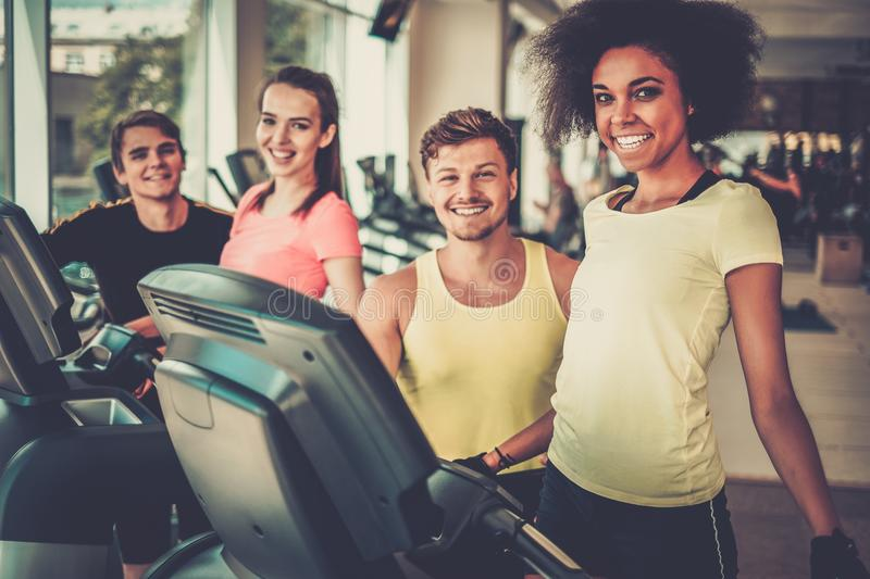 Trainer explaining how to use treadmill stock images