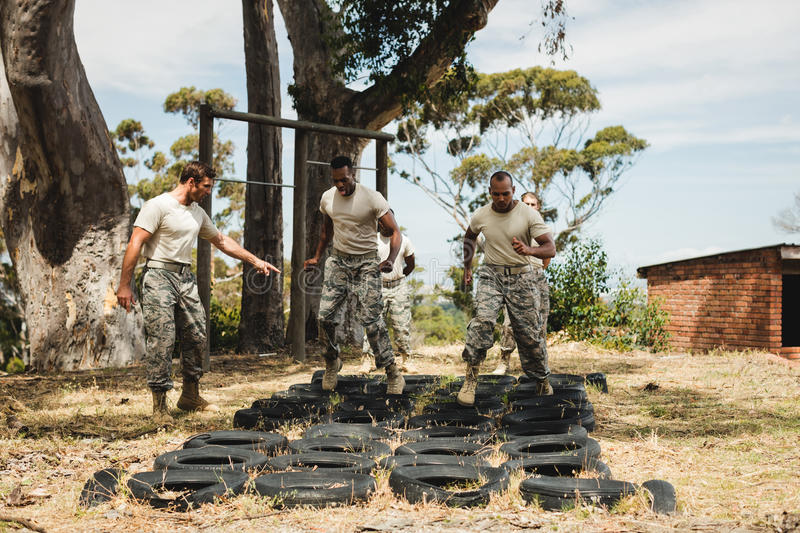 Trainer giving training to military soldiers royalty free stock photo