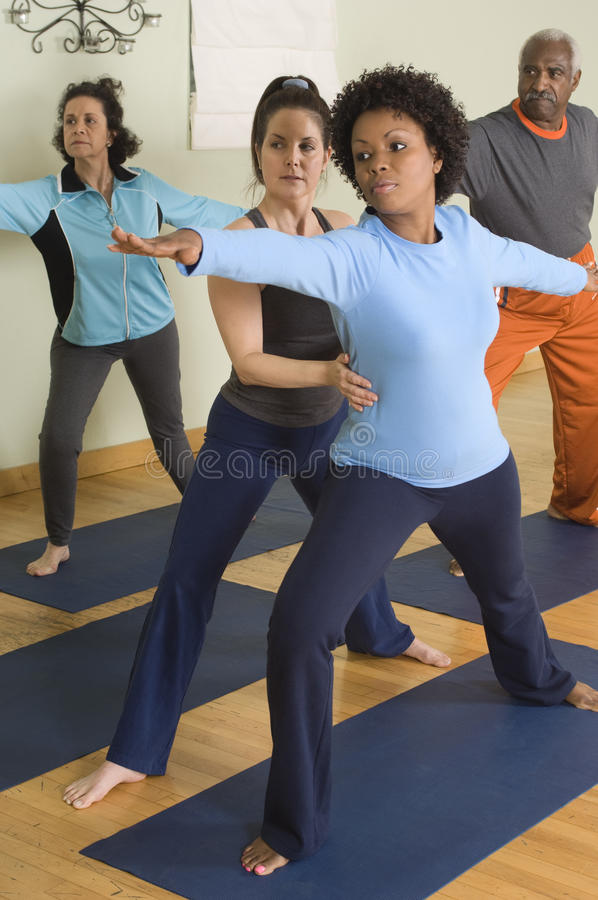 Trainer Helping Woman In Exercising royalty free stock images