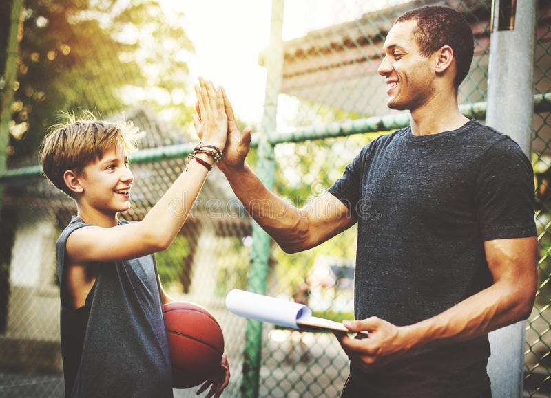 Download Trainer High-Five Teamwork Ability Concept Stock Photo - Image of concept, play: 71352626