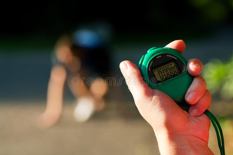 Trainer measuring time of sprinter royalty free stock photos