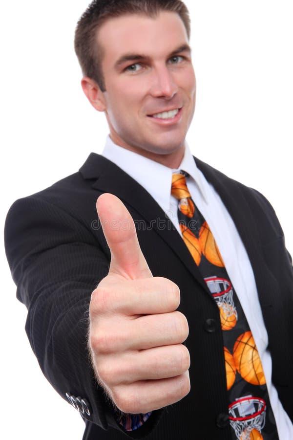Trainer mit den Daumen oben lizenzfreie stockfotografie