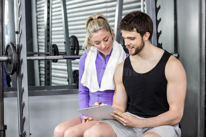 Trainer talking to his client royalty free stock images